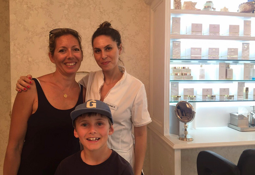 Arianna' skin care specialist, Rachel, hugs a customer and her young son at the store.