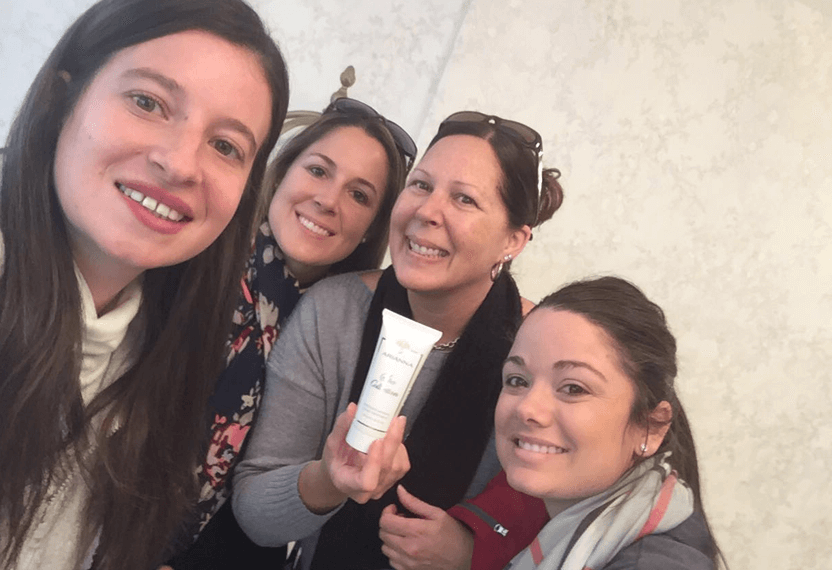 Customers taking a selfie smiling and showing Arianna's Intensive Mineral Hand Treatment.
