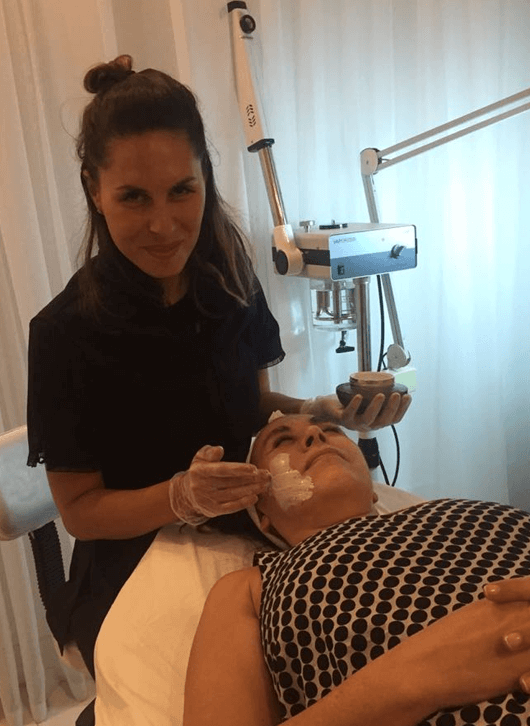 A customer receives a mask treatment at the Spa location.