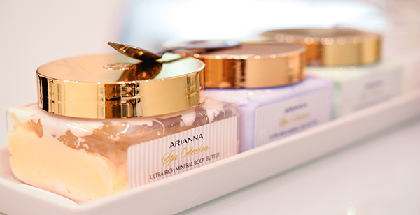 Arianna's body products with a golden spoon