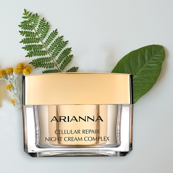 Arianna's Night Cream jar with natural elements in the background: leaves and flowers.